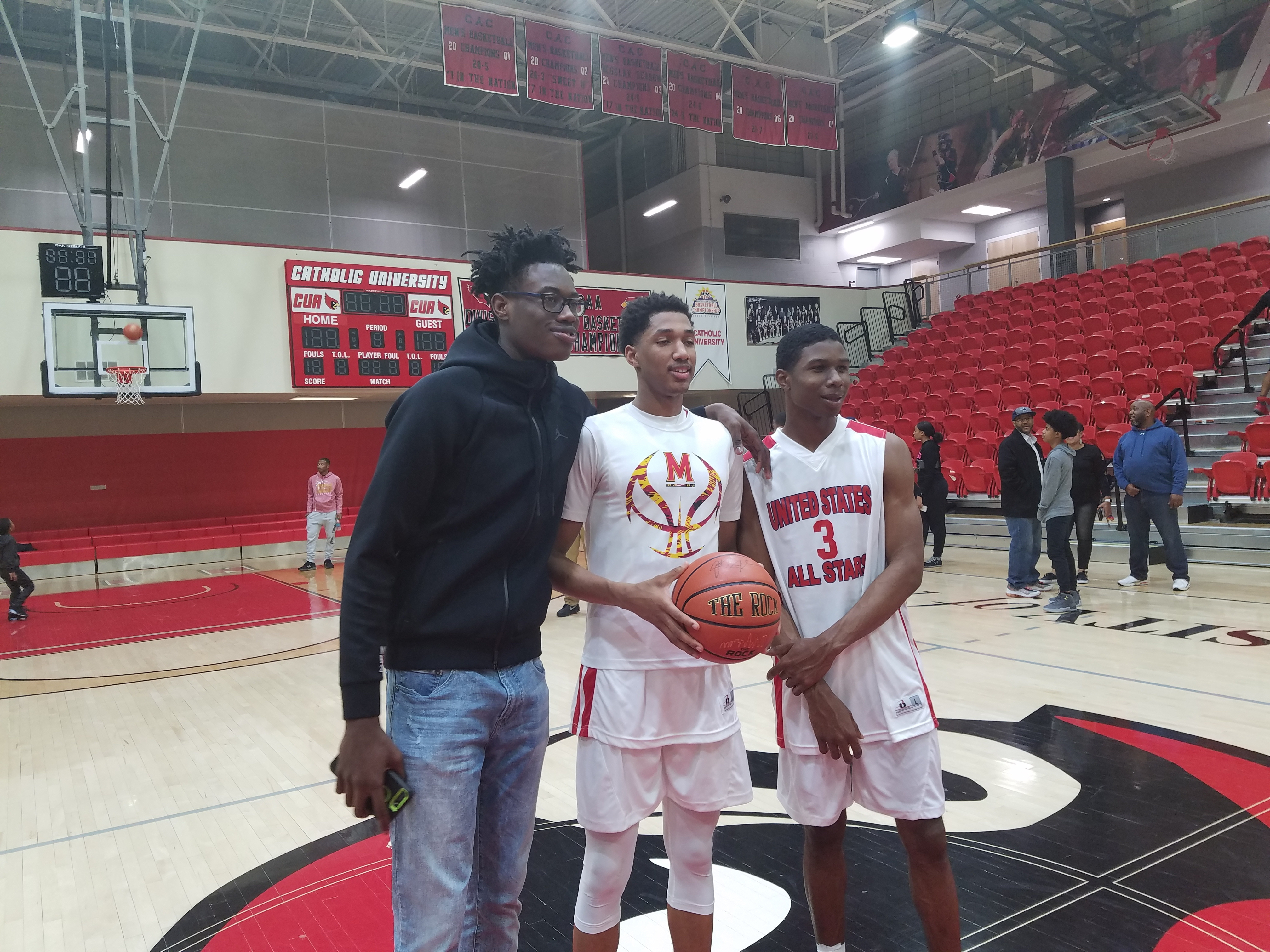 Andrew Wiggins, center, poses with fellow Maryland basketball recruits Jalen Smith, left, and Serrel Smith right, following Friday night's Capital Classic at Catholic University